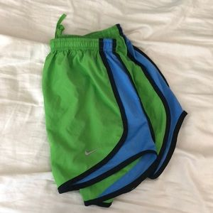 Green Nike Tempo Dri-Fit running shorts